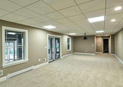 carpeted full basement with custom windows