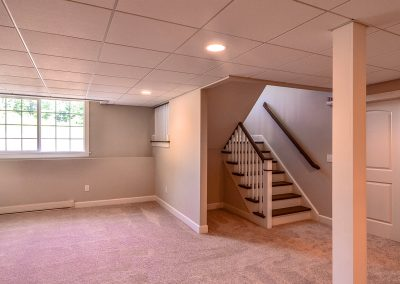 full basement with stairs and suspended ceiling