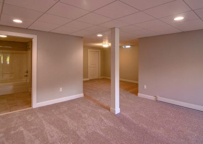 carpeted basement with bathroom