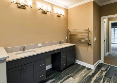 custom double vanity with square sinks and towel warmer