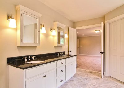 white double vanity with mirrored wall cabinets