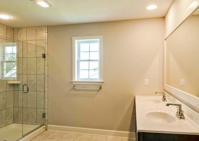 double vanity and tiled shower