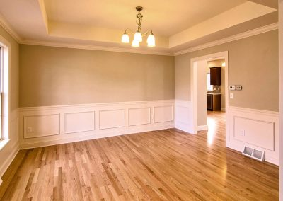 dining room with hardwood and tray ceiling
