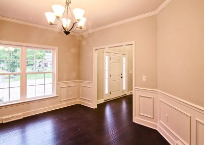 dining room with wall molding and crown molding