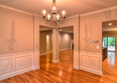dining room with corner entry and wall molding
