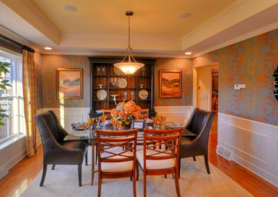 furnished dining room with tray ceiling
