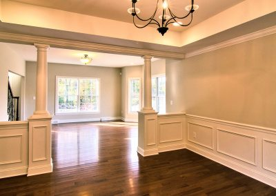 dining room with columns and tray ceiling