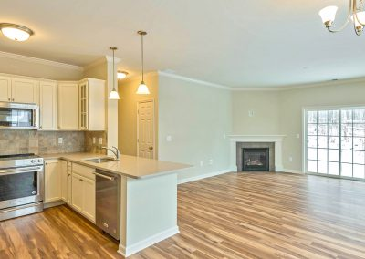 open plan kitchen and living area with corner fireplace