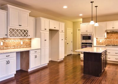 white kitchen with work station and wine rack