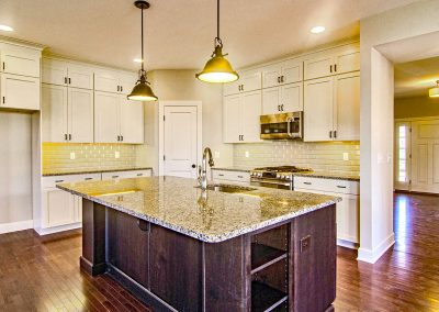 white kitchen with subway tile and large island