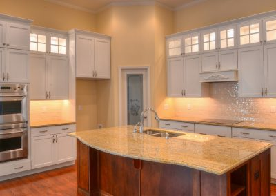 white kitchen with curved island countertop