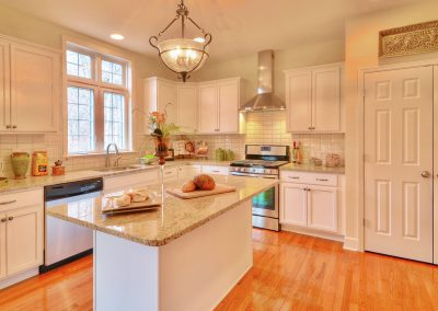 white kitchen with double door pantry