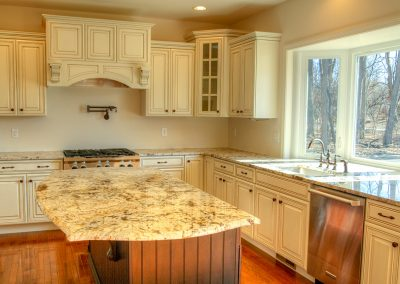 antiqued kitchen with corner pantry and curved island