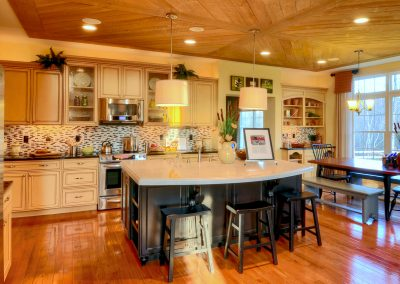 large eat in kitchen with decorative wood ceiling