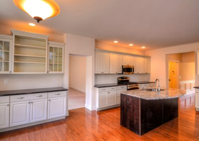 white kitchen with dish display cabinets