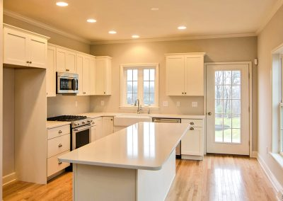 white kitchen with windows and exterior french door