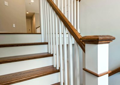 wooden staircase with detailing
