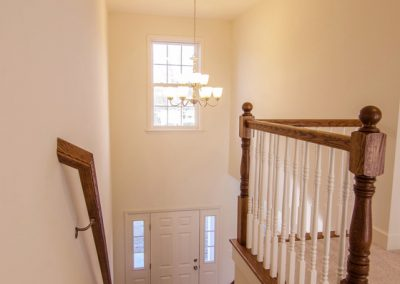 staircase with wooden wall railing