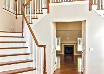 dual wooden staircase with balcony