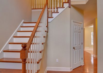 wooden staircase and railings