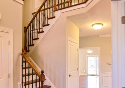 wooden staircase with iron spindles and wooden railing