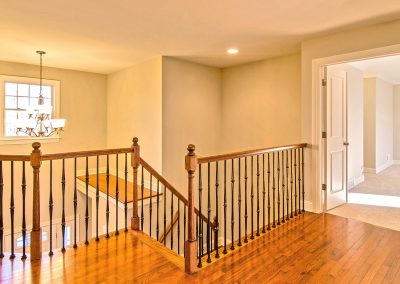 upper landing with iron spindles and wood railings