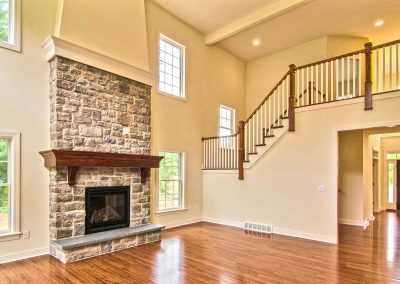 wooden railings overlooking two story family room