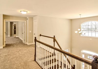 carpeted upper landing overlooking foyer and family room