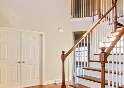 wooden staircase from foyer