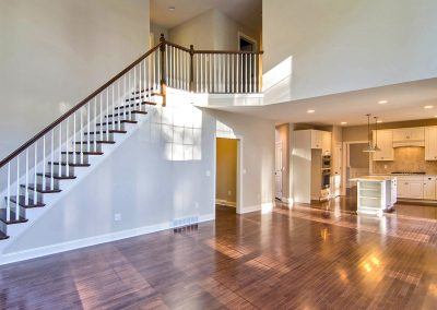 wooden staircase leading from family room