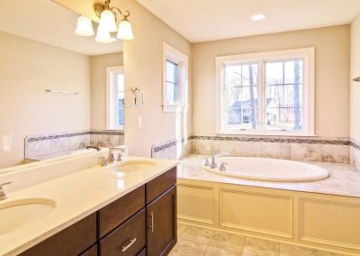double bowl vanity and bath tub
