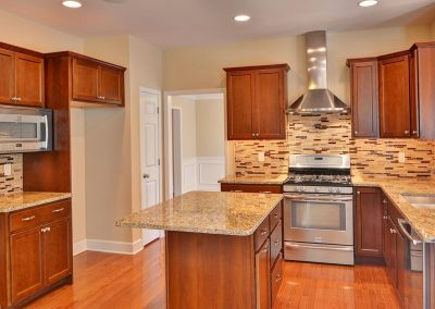 kitchen with island and vented hood
