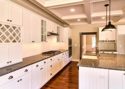 white cabinets with coffered ceiling