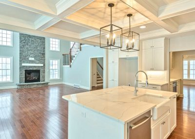 white cabinets and coffered ceiling