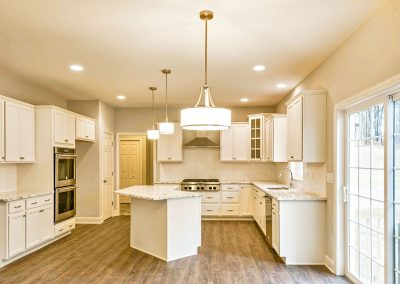 white kitchen with angled island